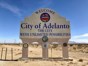 City of Adelanto water tank with clear blue skies in the background