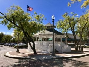 White gazebo with American flag in background in downtown Upland, CA